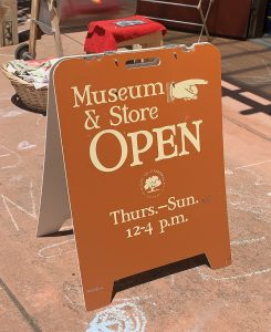 "sign says ""museum & store open Thurs-Sun 12-4 pm"""