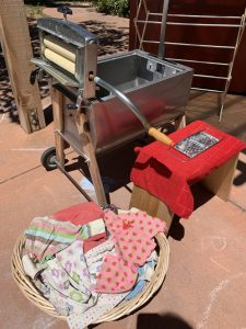 old-fashioned hand-washer and dryer press with pretend laundry