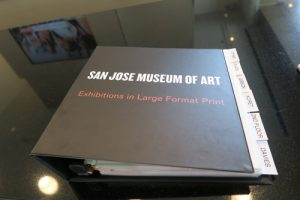 large print exhibition guide at San Jose Museum of Art