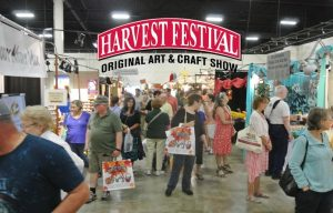 official marketing image of shoppers at the Harvest Festival