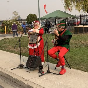 musicians dressed in Christmas clothes at Harvest Festival