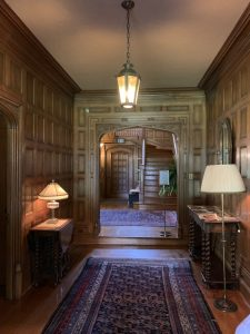 oak-paneled entry hall in Ainsley House in Campbell