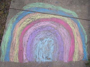 rainbow drawn in sidewalk chalk