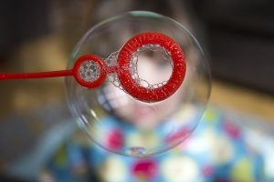 soap bubble hanging on a bubble wand