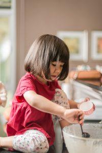 girl baking cupcakes